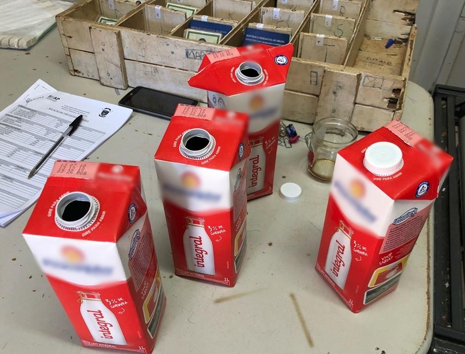 Mulher é detida ao tentar entrar com bebida alcoólica em caixas de leite no presídio de Jataí