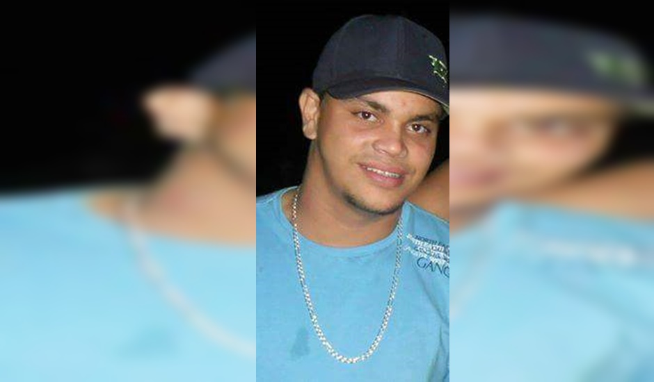 Henrique Resende de Oliveira, que tinha 23 anos, morto com dois tiros pelas costas em Goiânia: Suspeito preso (Foto: Reprodução | Arquivo Pessoal)